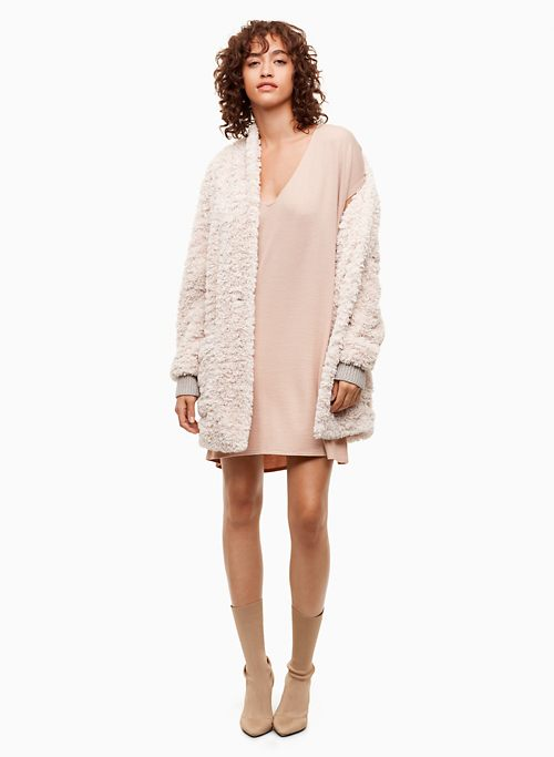 Color matching clothes beige dress