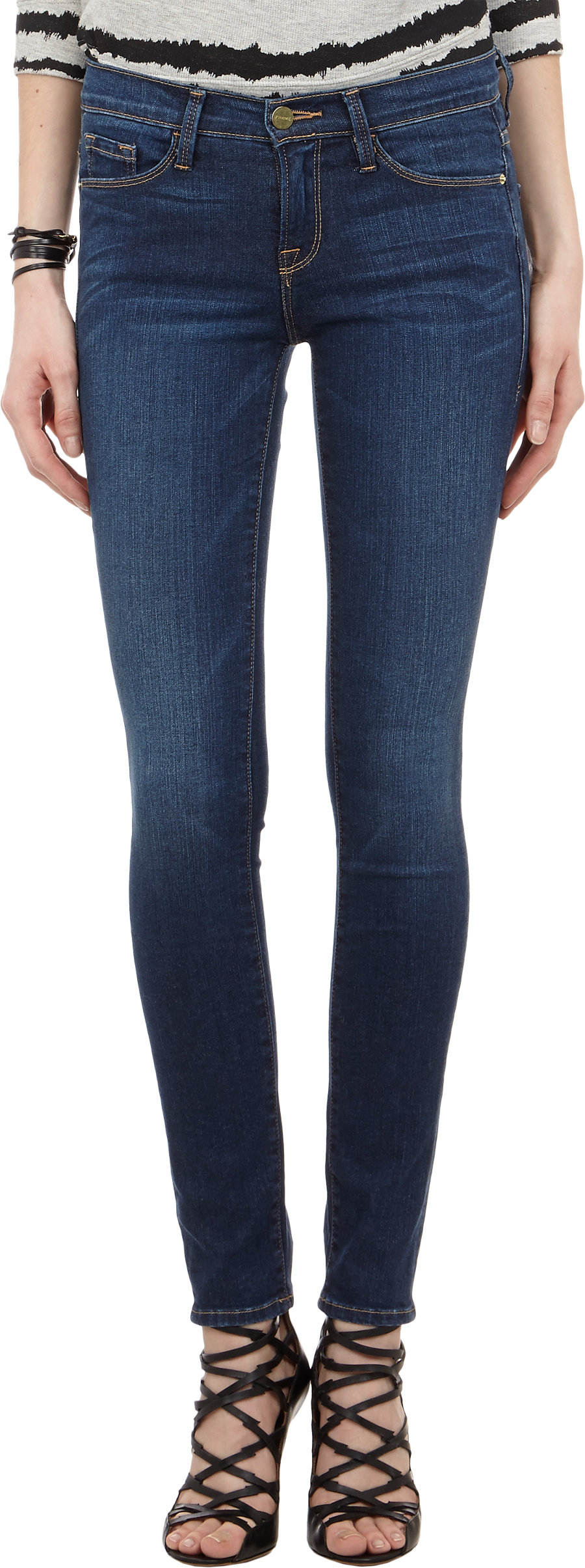 A pair of denim skinny jeans with a QUICK VIEW WARNING: This product can expose you to chemicals, including lead and/or phthalates, which are known to the State of California to cause cancer and birth defects or other reproductive harm.