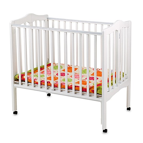 Small space living delta children 39 s portable crib in white from buy buy baby - Compact cribs small spaces model ...