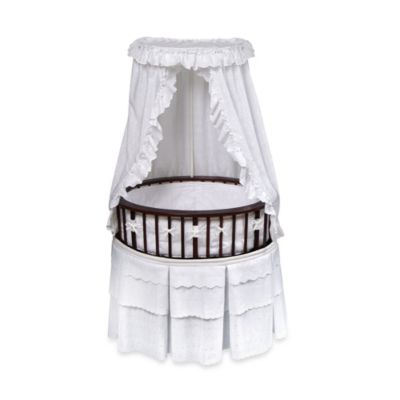Badger Basket Oval Bassinet in Cherry with White Eyelet Bedding