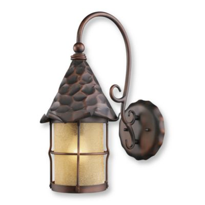 Antique Copper Outdoor Lighting with Amber Scavo Glass Sconce From the Rustica Collection