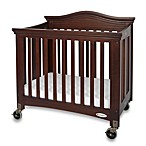 Foundations® Royale® Compact Fixed-Side Folding Crib in Antique Cherry