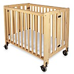 Foundations HideAway Easy Roll Compact Fixed-Side Folding Crib in Natural