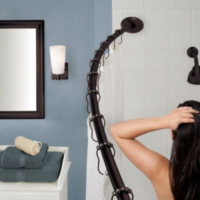 The Gripper™ Adjustable Curved Shower Rod in Oil Rubbed Bronze