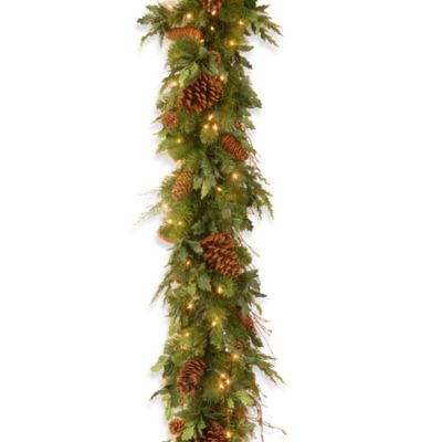 Decorative Collection 6-Foot x 12-Inch Juniper Mix Pine Pre-Lit Garland with 100 Clear Lights