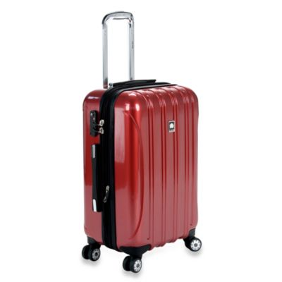 DELSEY Helium Aero 21-Inch Spinner Carry-On in Red
