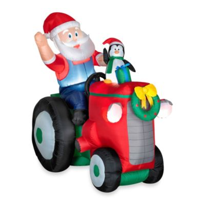 5.5-Foot Animated Inflatable Santa with Penguin on Tractor