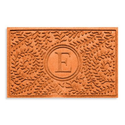 "Weather Guard™ Boxwood Monogrammed ""E"" 23-Inch x 35-Inch Door Mat in Orange"