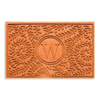 """Weather Guard™ Boxwood Monogrammed """"W"""" 23-Inch x 35-Inch Door Mat in Orange"""