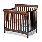 Child Craft™ Coventry Mini 4-in-1 Covertible Sleigh Crib in Cherry