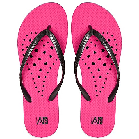 women s small elongated heart aquaflops shower shoes in pink unisex diagonal hole aquaflops shower shoes in royal blue