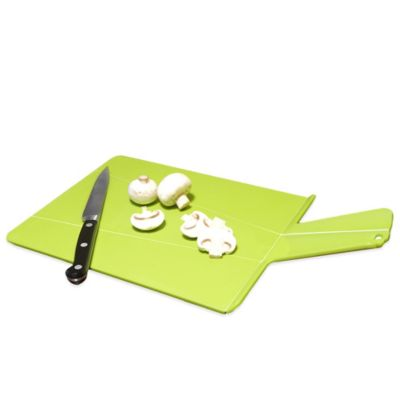 Joseph Joseph® Chop2Pot™ Chopping Board in Green
