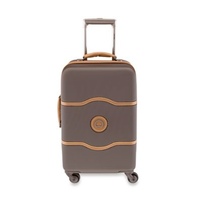 DELSEY Chatelet 21-Inch Upright Spinner Trolley in Brown
