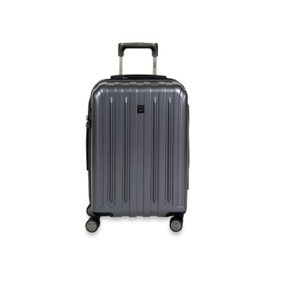 DELSEY Helium Titanium 20-Inch Carry-On Spinner in Graphite