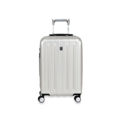 DELSEY Helium Titanium 20-Inch Carry-On Spinner in Silver