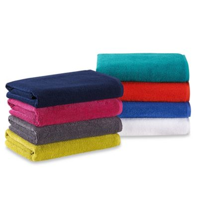 Anthology™ Solid Piece-Dyed Bath Towel in Magenta