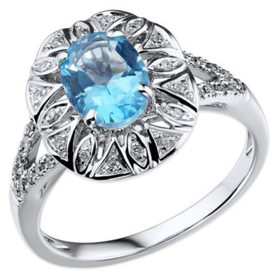 10K White Gold .13 cttw Diamond and Blue Topaz Size 6 Oval Split-Shank Cocktail Ring