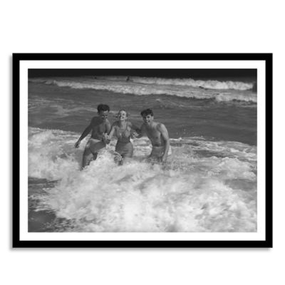 Two Young Men and Woman Playing in Wave Medium Framed Photographic Wall Art