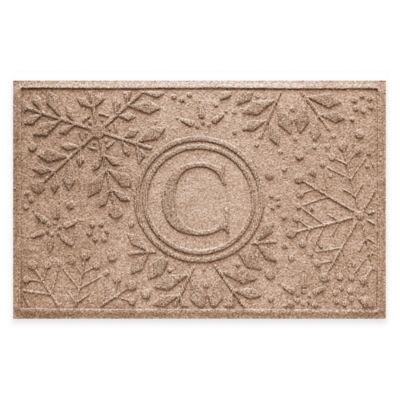 Bungalow Flooring Weather Guard™ Snowflake 23-Inch x 36-Inch Holiday Door Mat in Medium Brown