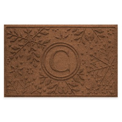 Bungalow Flooring Weather Guard™ Snowflake 23-Inch x 36-Inch Holiday Door Mat in Dark Brown