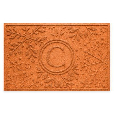 Bungalow Flooring Weather Guard™ Snowflake 23-Inch x 36-Inch Holiday Door Mat in Orange