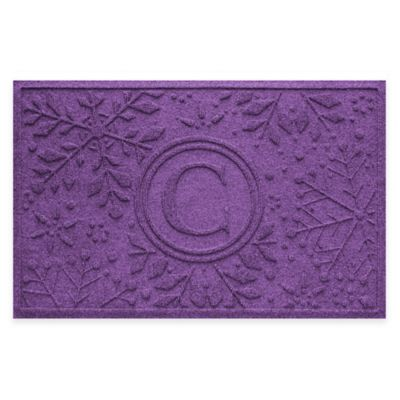 Bungalow Flooring Weather Guard™ Snowflake 23-Inch x 36-Inch Holiday Door Mat in Purple