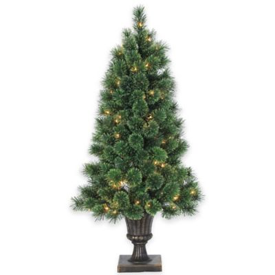 Deluxe Cashmere Pine 4-Foot Pre-Lit Potted Christmas Tree with Decorative Urn and Clear Lights