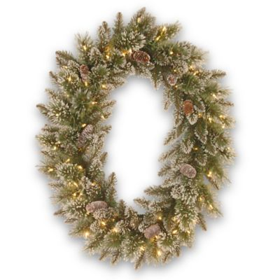 National Tree Company 30-Inch Glittery Bristle Pine Pre-Lit Oval Wreath with Warm White Lights