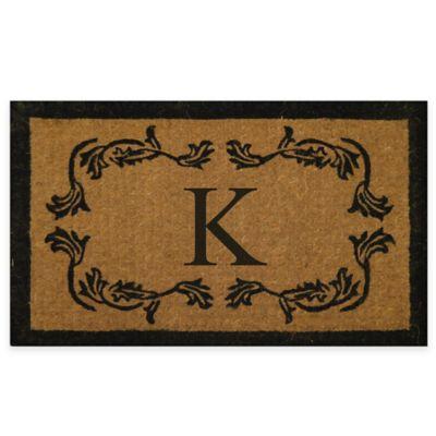 """Leaf Bordered 18-Inch x 30-Inch Monogrammed Letter """"K"""" Door Mat in Natural Black"""