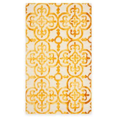Safavieh Dip Dye Clover 4-Foot x 6-Foot Area Rug in Ivory/Gold