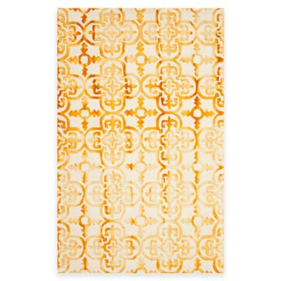 Safavieh Dip Dye Clover 6-Foot x 9-Foot Area Rug in Ivory/Gold