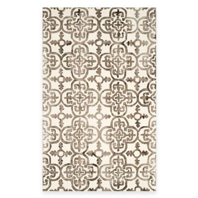 Safavieh Dip Dye Clover 9-Foot x 12-Foot Area Rug in Ivory/Brown