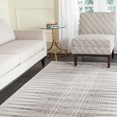 Safavieh Evoke Collection Tribal 6-Foot 7-Inch x 9-Foot Area Rug in Royal/Ivory