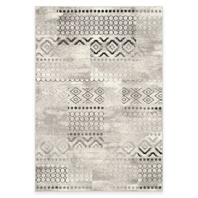 Safavieh Evoke Collection Southwest 5-Foot 1-Inch x 7-Foot 6-Inch Area Rug in Cream/Dark Grey