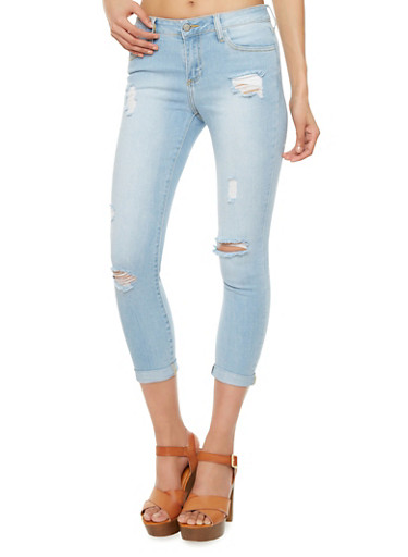 Ripped Skinny Jeans With Light Wash Denim And Rolled Cuffs