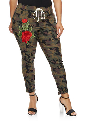 Plus Size Camo Print Pants with Floral Applique at Rainbow Shops in Jacksonville, FL | Tuggl