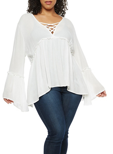 Plus Size Caged V Neck High Low Top at Rainbow Shops in Daytona Beach, FL | Tuggl