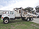 , mounted on1999 International 4900 6x6 Flatbed Truck