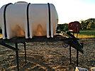 1000 Gallon Calcium Chloride Road Sprayer Insert, with Poly tank, hyd powered pump, spray bar & hose rack