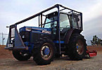 1994 Ford/New Holland 7740SL 4x4 Rubber Tired Utility Tractor, s/n BD64705, Ford 5.0L diesel, 8 spd, with PTO, 3-pt. hitch, aux. hyd & ROPS with sweeps/screens, front winch & Brown 6' brush cutter, Reads ...