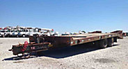 1997 Towmaster T-40 10-Ton T/A Tagalong Trailer, with 19' level deck over wheels, beavertail & ramps