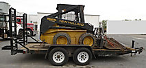 2002 New Holland LX665 Rubber Tired Skid Steer Loader