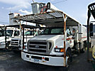 Aerial Lift of CT AL-65/53-5-IL-4H, Over-Center Bucket Truck mounted behind cab on 2004 Ford F750 Chipper Dump Truck