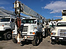 Altec AC35-127S, 35 Ton, Hydraulic Crane, rear mounted on, 2003 Sterling LT9500 T/A Tri-Axle Flatbed Truck