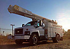 Altec AM855-MH, Over-Center Material Handling Bucket Truck, rear mounted on, 2005 Chevrolet C7500 Utility Truck