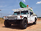 Altec AT250-G, Articulating & Telescopic Bucket Truck mounted behind cab on 1996 AM General Hummer Utility Vehicle