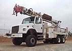 Altec D4060-TR, Digger Derrick, rear mounted on, 2002 Freightliner FL80 6x6 Flatbed/Utility Truck