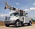 Altec DM47-TR, Digger Derrick, rear mounted on, 2007 International 4300 Utility Truck
