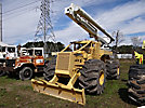 Altec LRV-52, Over-Center Bucket Truck, rear mounted on Timberjack 350 Articulating Log Skidder