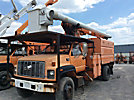 Altec LRV-55, Over-Center Bucket Truck, mounted behind cab on, 2002 GMC C7500 Chipper Dump Truck